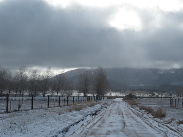 Snowy road near ranch